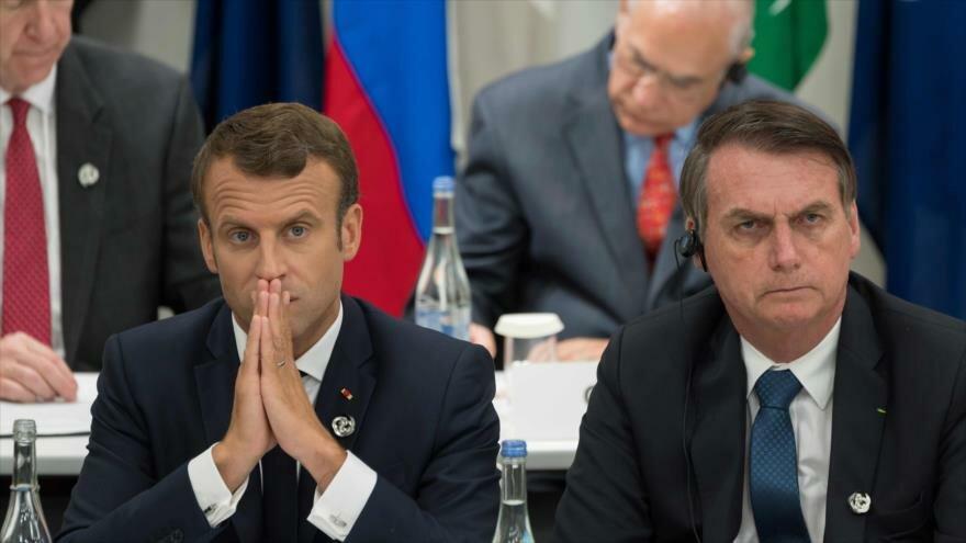 El presidente de Brasil, Jair Bolsonaro (drcha.), y su par francés, Emmanuel Macron, desde la ciudad japonesa de Osaka, 28 de junio de 2019. (Foto: AFP)