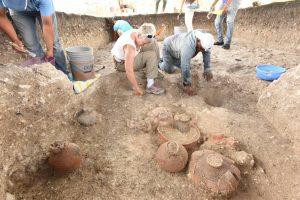 3-Daniela-Triadan-center-excavating-Cache-NR4-900-800-BC-with-multiple-ceramic-vessels-at-Aguada-Fenix - 3-Daniela-Triadan-center-excavating-Cache-NR4-900-800-BC-with-multiple-ceramic-vessels-at-Aguada-Fenix-300x200
